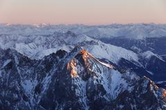 view from zugspitze mountain over hochwanner mountain, 2744m asl, in the even - stock photo