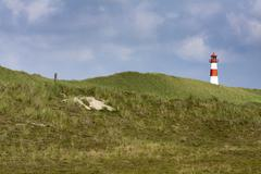Red and white striped lighthouse of list ost on the sylt peninsula of ellenbo Stock Photos
