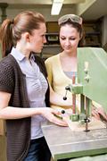 Young female teacher and a teenage schoolgirl in the handwork classroom Stock Photos