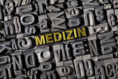 Old lead letters forming the word medizin, german for medicine Stock Photos