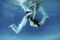 Stock Photo of underwater wedding in pool, odessa, ukraine, eastern europe