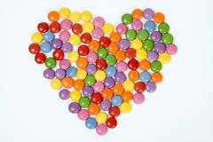 heart of coloured confectionary - stock photo