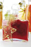 Bathing lotion, bottles with christmas decoration Stock Photos