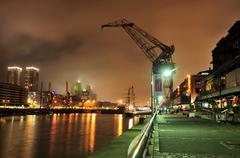 Stock Photo of the old harbour puerto madero at night, restored for tourists, buenos aires,