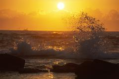 waves and surf at sunset in bundjalung national park, new south wales, austra - stock photo