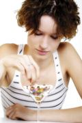 Young woman with a coacktail of pills Stock Photos