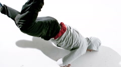 Cool young break dancer dancing on white background Stock Footage