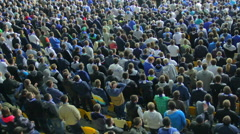 Shouting fans support team football match stadium, one hand air Stock Footage