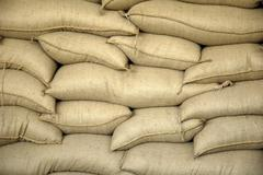 stacked sacks in a food storage, food reserves of the german federal republic - stock photo