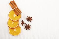 dried slices of orange with cinnamon sticks and anise stars - stock photo
