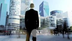 Businessman walking in the city - young professional success modern urban Stock Footage
