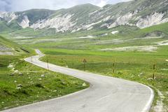 windy mountain road in the gran sasso of the abruzzo region of italy, europe - stock photo