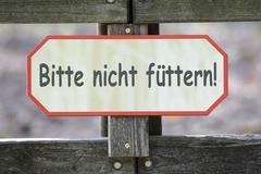 Signpost, please do not feed! Stock Photos