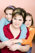 Mother, 36, with two daughters, 9 and 6 years Stock Photos