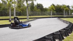 Children go kart race track Stock Footage