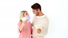 Attractive young couple flashing their cash Stock Footage
