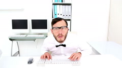 Nerd typing and getting stressed at desk Stock Footage