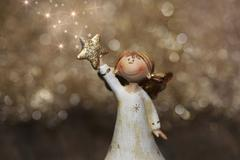 Golden christmas or guardian angel with stars for decoration Stock Illustration