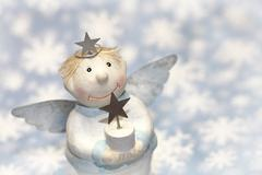 Blue christmas or guardian angel  with snowflakes for decoration Kuvituskuvat