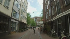 Cycling through Amsterdam speeded up Stock Footage
