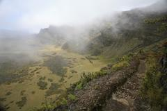 shreds of clouds racing through thermals above the crater in haleakala nation - stock photo