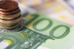 Euro-bills and coins Stock Photos