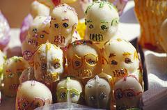 Marzipan skull good luck charms at the day of the dead festival during all sa Stock Photos