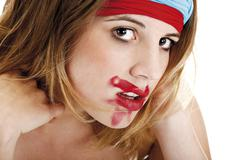 Stock Photo of young woman with colourful headbands and smeared lipstick