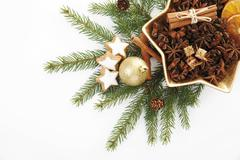 branches of fir with a christmas tree bauble, cinnamon stars and a christmas  - stock photo