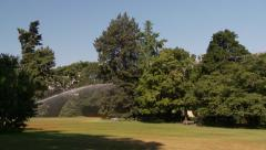Rainbow caused by a water spinkler in Zurich park Stock Footage