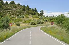 curve on an isolated country road with a no overtaking sign, cuenca province, - stock photo