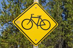 road sign, bicycle on a yellow diamond, usa - stock photo