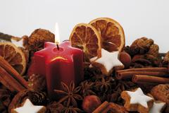 Stock Photo of lit candle and christmas decoration