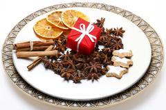 Christmas present, star anise, cinnamon sticks and dried slices of orange on  Stock Photos