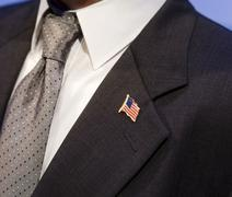 Stock Photo of stars and stripes pin on the lapel of a suit