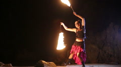 Artist turns the fiery fire-snakes fire performance Stock Footage