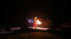 Artist turns the fire snakes performance Stock Footage