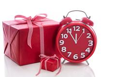 Christmas: big red gift box with red alarm clock - last minute christmas shop Stock Photos