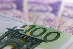 euro-bills and czech crowns - stock photo