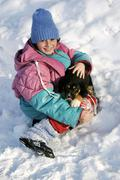 Girl, 10 years, with puppy in the snow, sidonie, white carpathian mountains p Stock Photos