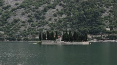 Seascape with a church on the island. Panorama with old town and stone wall. Stock Footage