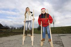 Little girls, 11 and 10 years old, on stilts, outside Stock Photos