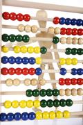 Wooden jointed figure with an abacus Stock Photos