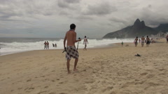 Rio de Janeiro Ipanema Beach man taking photos on beach s Stock Footage
