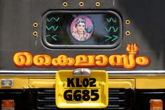 Back of an auto rickshaw with malayalam lettering and a depiction of shiva, n Stock Photos