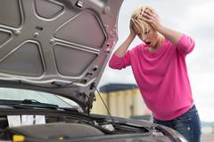Stressed Young Woman with Car Defect. Stock Photos
