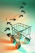 shopping trolley and arrow signs - stock photo