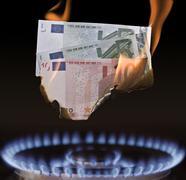 Gas flame burning euro-bills Stock Photos