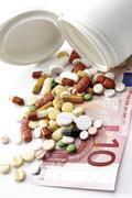 Pills on a ten euro-bill Stock Photos
