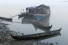 Boat on the irrawaddy or ayeyarwady river in the morning fog, bhamo, myanmar, Stock Photos